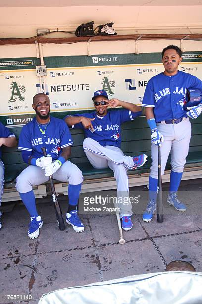 Jose Reyes Emilio Bonifacio and Maicer Izturis of the Toronto Blue Jays relax in the dugout prior to the game against the Oakland Athletics at Oco...