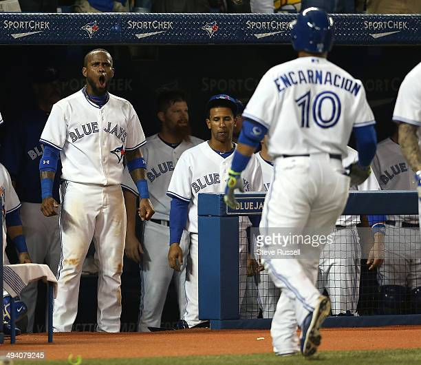 TORONTO ON MAY 27 Jose Reyes greets Edwin Encarnacion after he homered as the Toronto Blue Jays play the Tampa Bay Rays at Rogers Centre in Toronto...