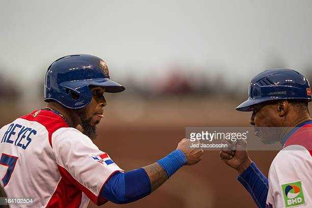 Jose Reyes of Team Dominican Republic is greeted by third base coach Juan Samuel in the bottom of the first inning of the 2013 World Baseball Classic...