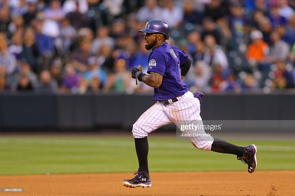 <a gi-track='captionPersonalityLinkClicked' href=/galleries/search?phrase=Jose+Reyes+-+Baseball+Player&family=editorial&specificpeople=203307 ng-click='$event.stopPropagation()'>Jose Reyes</a> #7 of the Colorado Rockies advances to second base on a wild throw from Starting pitcher Jordan Zimmermann of the Washington Nationals during the first inning at Coors Field on August 18, 2015 in Denver, Colorado.