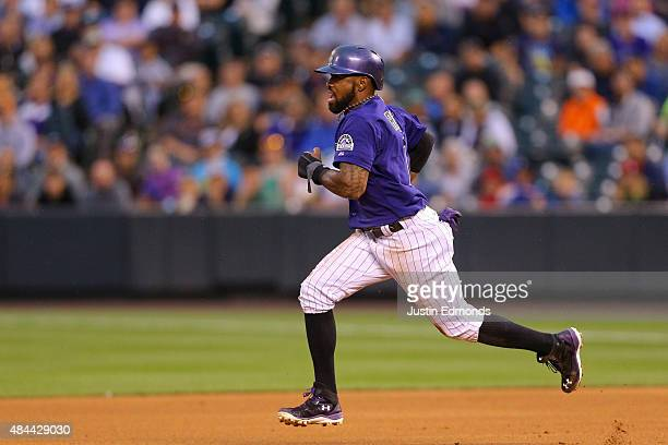 Jose Reyes of the Colorado Rockies advances to second base on a wild throw from Starting pitcher Jordan Zimmermann of the Washington Nationals during...