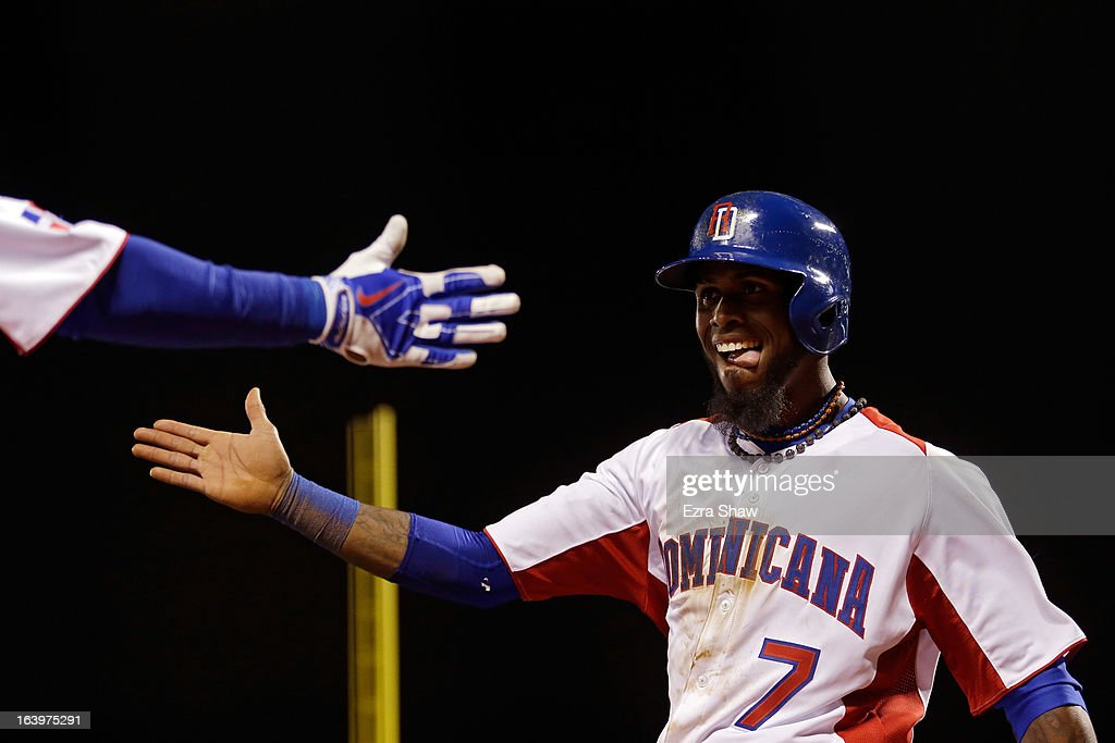Jose Reyes #7 of the Dominican Republic celebrates after scoring in the fifth inning against the Netherlands during the semifinal of the World Baseball Classic at AT&T Park on March 18, 2013 in San Francisco, California.