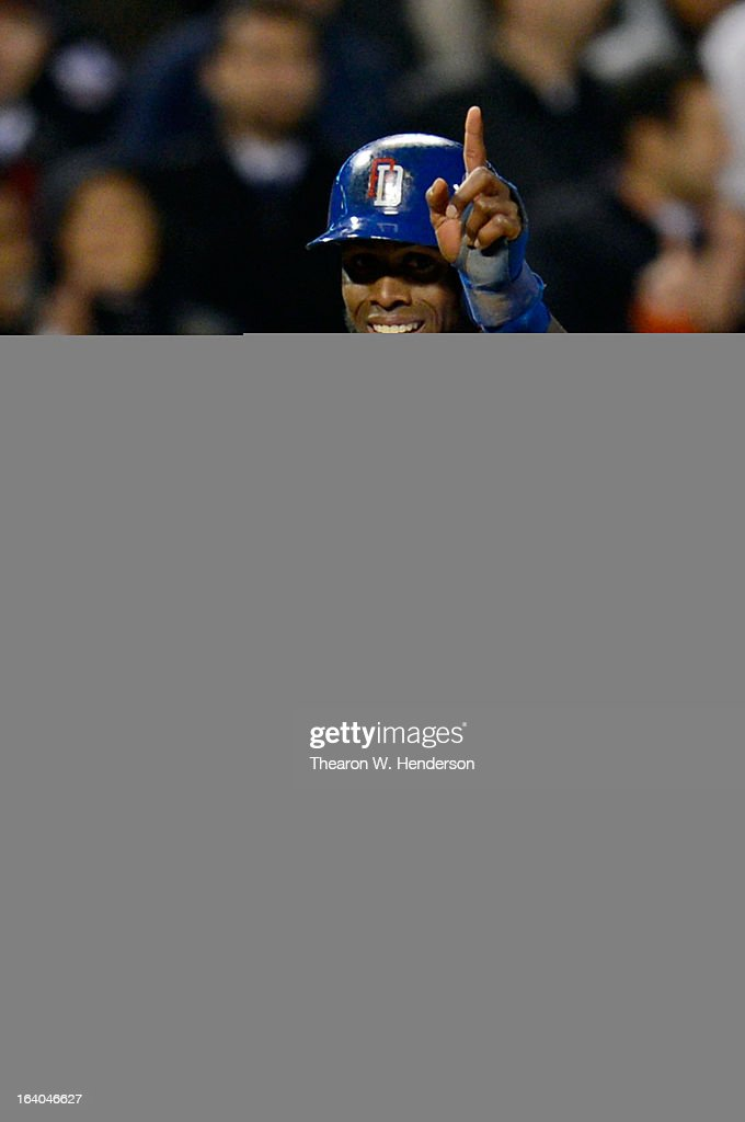 Jose Reyes #7 of the Dominican Republic celebrates from third base in the fifth inning against the Netherlands during the semifinal of the World Baseball Classic at AT&T Park on March 18, 2013 in San Francisco, California.