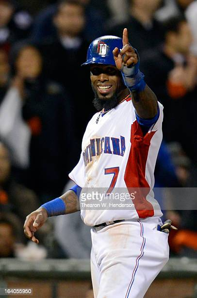 Jose Reyes of the Dominican Republic celebrates from third base in the fifth inning against the Netherlands during the semifinal of the World...