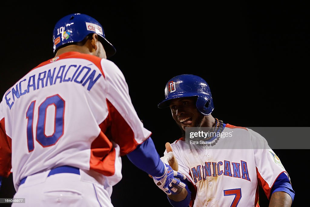 Jose Reyes #7 of the Dominican Republic celebrates with Edwin Encarnacion #10 after scoring in the fifth inning against the Netherlands during the semifinal of the World Baseball Classic at AT&T Park on March 18, 2013 in San Francisco, California.