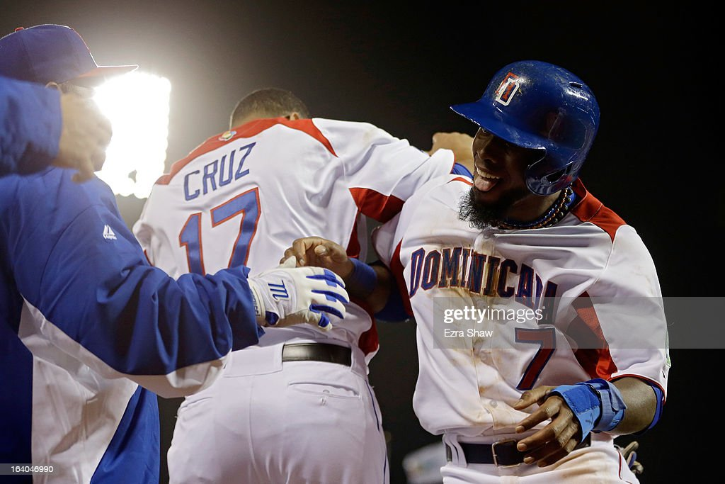 Jose Reyes #7 of the Dominican Republic celebrates with Nelson Cruz #17 after scoring in the fifth inning against the Netherlands during the semifinal of the World Baseball Classic at AT&T Park on March 18, 2013 in San Francisco, California.
