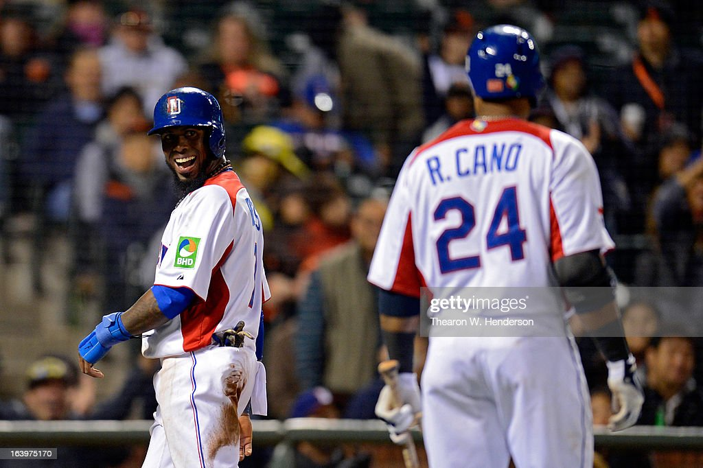 Jose Reyes #7 of the Dominican Republic celebrates with Robinson Cano #24 after scoring in the fifth inning against the Netherlands during the semifinal of the World Baseball Classic at AT&T Park on March 18, 2013 in San Francisco, California.