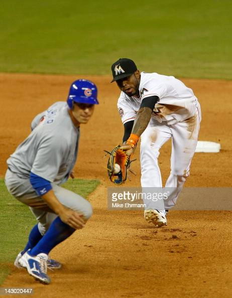 Jose Reyes of the Miami Marlins chases down Bryan LaHair of the Chicago Cubs in a rundown during a game at Marlins Park on April 17 2012 in Miami...