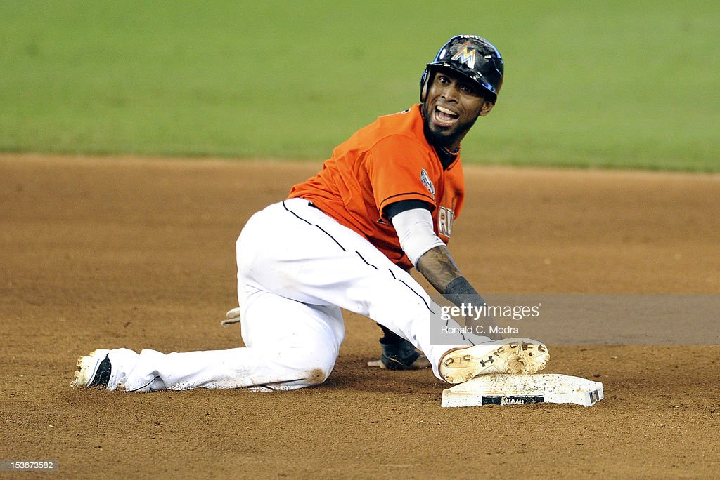 Jose Reyes #7 of the Miami Marlins slides into second base during a MLB game against the New York Mets at Marlins Park on October 3, 2012 in Miami, Florida.