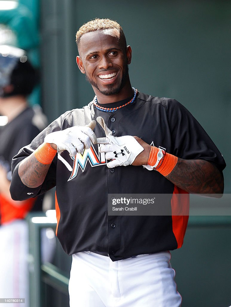 Jose Reyes #7 of the Miami Marlins smiles in the dugout during a game against the Detroit Tigers at Roger Dean Stadium on March 6, 2012 in Jupiter, Florida.