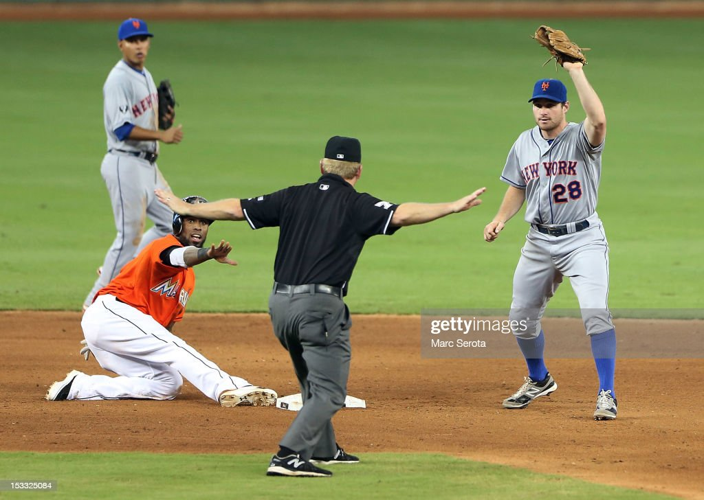 Jose Reyes #7 of the Miami Marlins steals second base against Danial Murphy #28 of the New York Mets at Marlins Park on October 3, 2012 in Miami, Florida.