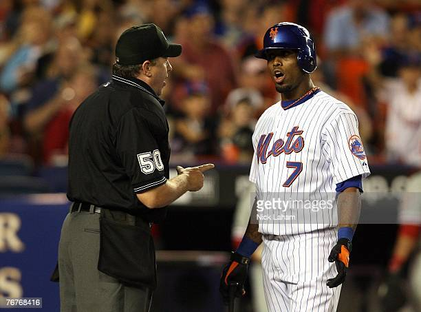 Jose Reyes of the New York Mets argues with home plate umpire Paul Emmel in a game against the Philadelphia Phillies at Shea Stadium September 14...