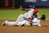Jose Reyes of the New York Mets asks for a time out after stealing second base in the ninth inning as Erick Aybar the Los Angeles Angels of Anaheim...