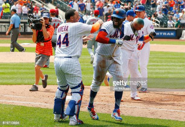 Jose Reyes of the New York Mets celebrates his ninth inning gamewinning infield base hit against the St Louis Cardinals with teammate Rene Rivera on...