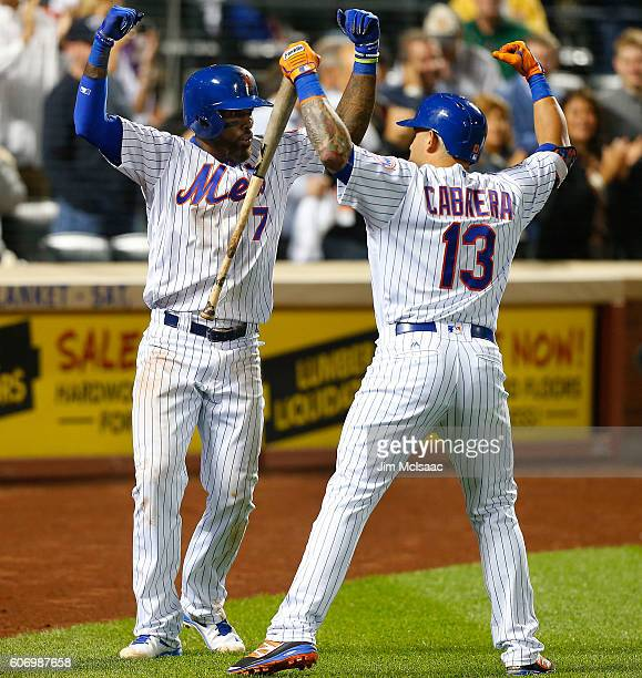 Jose Reyes of the New York Mets celebrates his third inning home run against the Minnesota Twins with teammate Asdrubal Cabrera at Citi Field on...