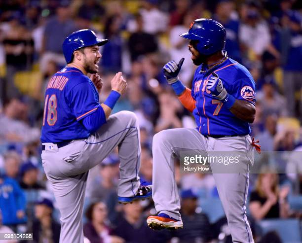 Jose Reyes of the New York Mets celebrates his two run homerun his second homerun of the game with Travis d'Arnaud to trail the Los Angeles Dodgers...