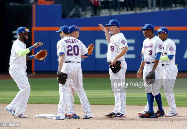 Jose Reyes of the New York Mets celebrates the win with teammates Neil WalkerAsdrubal CabreraJay Bruce Curtis Granderson and Yoenis Cespedes after...