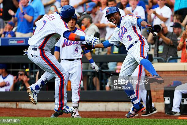 Jose Reyes of the New York Mets celebrates with Curtis Granderson after hitting his second home run of the game in the third inning against the...