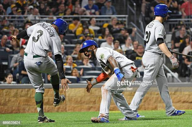 Jose Reyes of the New York Mets celebrates with Curtis Granderson after coming around to score on an RBI double by Jay Bruce in the fifth inning...