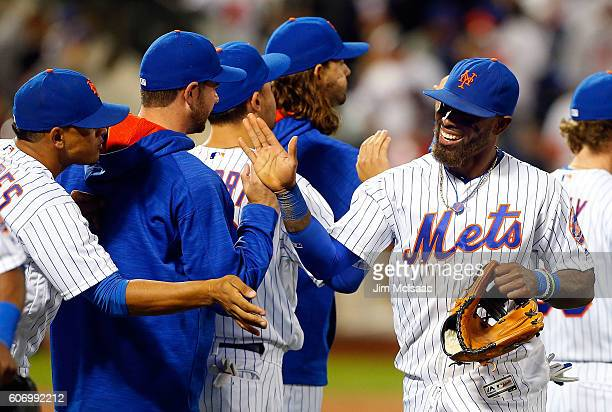 Jose Reyes of the New York Mets celebrates with his teammates after defeating the Minnesota Twins at Citi Field on September 16 2016 in the Flushing...