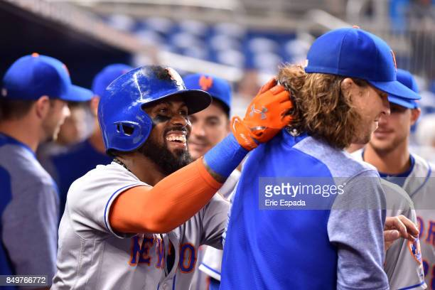 Jose Reyes of the New York Mets grabs the hair of Jacob deGroms after hitting a home run in the first inning against the Miami Marlins at Marlins...