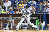 Jose Reyes of the New York Mets hits a single in the 7th inning during the game between the Miami Marlins and the New York Mets at Marlins Park on...