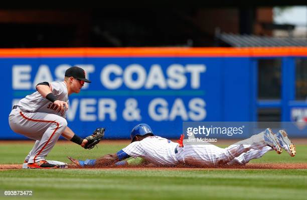 Jose Reyes of the New York Mets in action against Christian Arroyo of the San Francisco Giants at Citi Field on May 10 2017 in the Flushing...