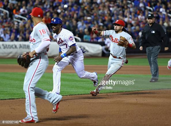 Jose Reyes of the New York Mets is caught in a rundown in the fourth inning against the Philadelphia Phillies during their game at Citi Field on...