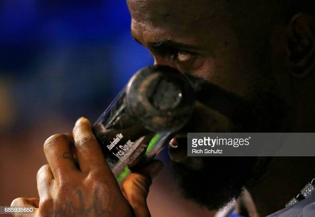 Jose Reyes of the New York Mets kisses his bat in the dugout during a game against the Philadelphia Phillies at Citizens Bank Park on April 10 2017...