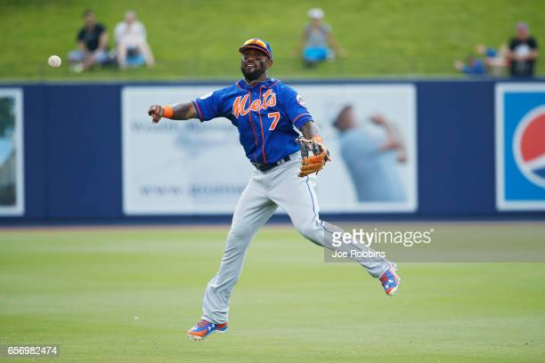 Jose Reyes of the New York Mets makes a play after fielding the ball in the sixth inning of a Grapefruit League spring training game against the...