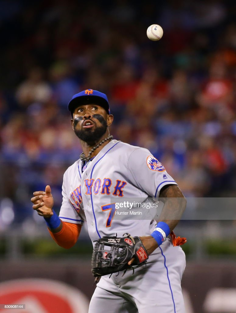 Jose Reyes #7 of the New York Mets mishandles a ground ball in the fifth inning during a game against the against the Philadelphia Phillies at Citizens Bank Park on August 12, 2017 in Philadelphia, Pennsylvania. The Phillies won 3-1.