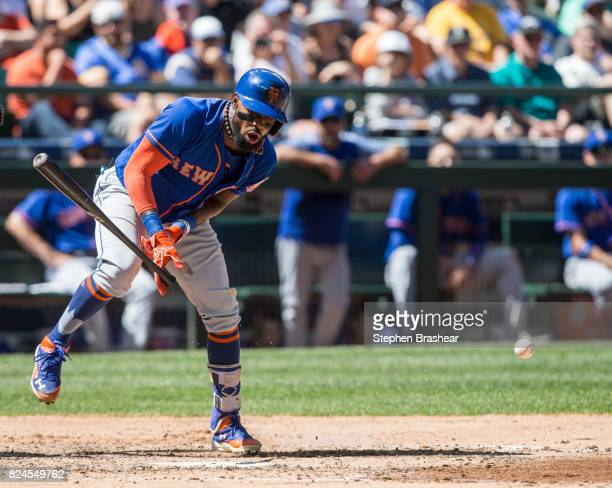 Jose Reyes of the New York Mets reacts after getting hit in the arm by pitch thrown by starting pitcher James Paxton of the Seattle Mariners during...