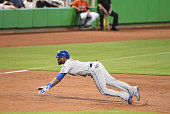 Jose Reyes of the New York Mets slides into third base during a MLB game against the Miami Marlins at Marlins Park on July 24 2016 in Miami Florida