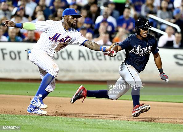 Jose Reyes of the New York Mets tags out Mallex Smith of the Atlanta Braves during a rundown in the sixth inning during their game at Citi Field on...
