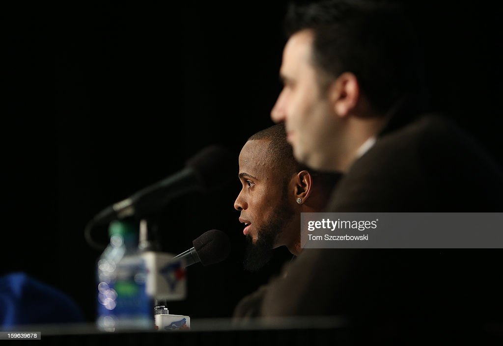 Jose Reyes #7 (L) of the Toronto Blue Jays answers questions as he is introduced at a press conference as general manager Alex Anthopoulos looks on at Rogers Centre on January 17, 2013 in Toronto, Ontario.