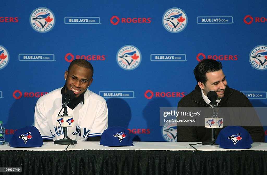 Jose Reyes #7 (L) of the Toronto Blue Jays answers questions from reporters at a press conference next to general manager Alex Anthopoulos at Rogers Centre on January 17, 2013 in Toronto, Ontario.