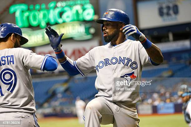Jose Reyes of the Toronto Blue Jays celebrates his home run with teammate Jose Bautista during the third inning of a game on June 22 2015 at...
