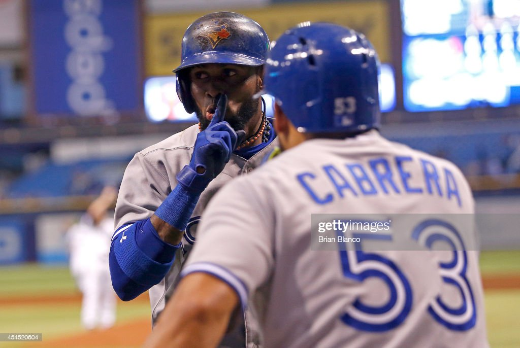 Jose Reyes #7 of the Toronto Blue Jays celebrates his three-run home run with teammate Melky Cabrera #53 during the fourth inning of a game on September 2, 2014 at Tropicana Field in St. Petersburg, Florida.