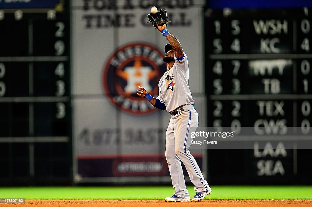 Jose Reyes #7 of the Toronto Blue Jays fields a fly ball in the seventh inning during a game against the Houston Astros at Minute Maid Park on August 25, 2013 in Houston, Texas. Toronto won the game 2-1.