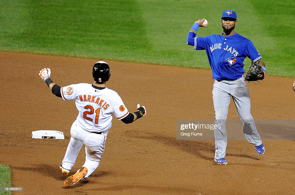 Jose Reyes #7 of the Toronto Blue Jays forces out Nick Markakis #21 of the Baltimore Orioles to start a double play in the fifth inning at Oriole Park at Camden Yards on September 26, 2013 in Baltimore, Maryland.
