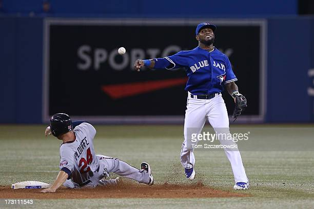 Jose Reyes of the Toronto Blue Jays gets the force out at second base but cannot turn the double play in the sixth inning during MLB game action as...
