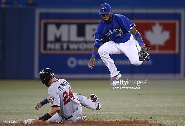 Jose Reyes of the Toronto Blue Jays gets the force out at second base in the fourth inning during MLB game action as Trevor Plouffe of the Minnesota...