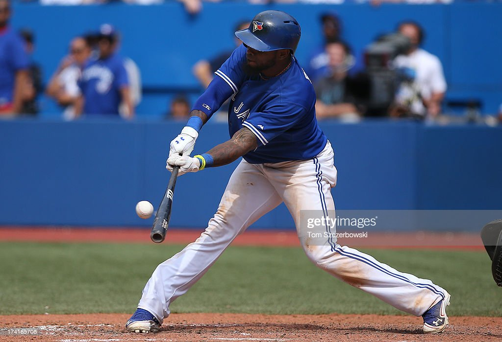 Jose Reyes #7 of the Toronto Blue Jays hits a 2-run double in the ninth inning during MLB game action against the Tampa Bay Rays on July 21, 2013 at Rogers Centre in Toronto, Ontario, Canada.