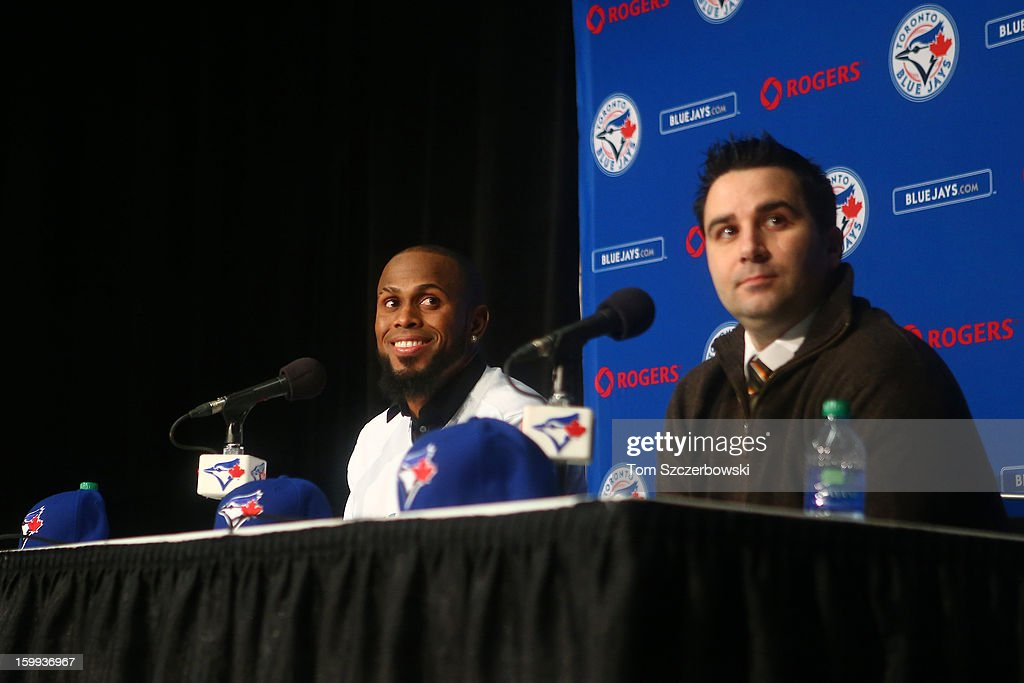 Jose Reyes #7 of the Toronto Blue Jays is introduced at a press conference as general manager Alex Anthopoulos looks on at Rogers Centre on January 17, 2013 in Toronto, Ontario, Canada.