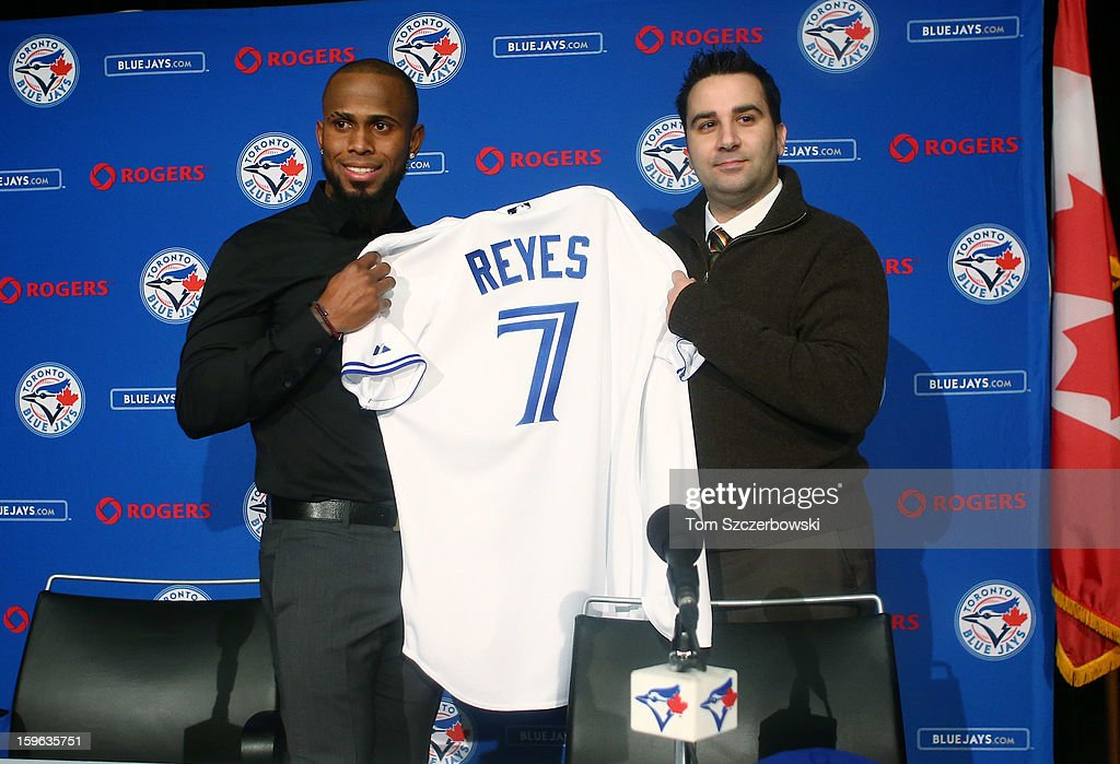 Jose Reyes #7 of the Toronto Blue Jays is introduced at a press conference by general manager <a gi-track='captionPersonalityLinkClicked' href=/galleries/search?phrase=Alex+Anthopoulos&family=editorial&specificpeople=6770623 ng-click='$event.stopPropagation()'>Alex Anthopoulos</a> at Rogers Centre on January 17, 2013 in Toronto, Ontario.