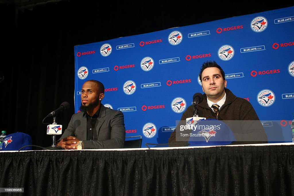 Jose Reyes #7 of the Toronto Blue Jays is introduced at a press conference next to general manager <a gi-track='captionPersonalityLinkClicked' href=/galleries/search?phrase=Alex+Anthopoulos&family=editorial&specificpeople=6770623 ng-click='$event.stopPropagation()'>Alex Anthopoulos</a> at Rogers Centre on January 17, 2013 in Toronto, Ontario, Canada.