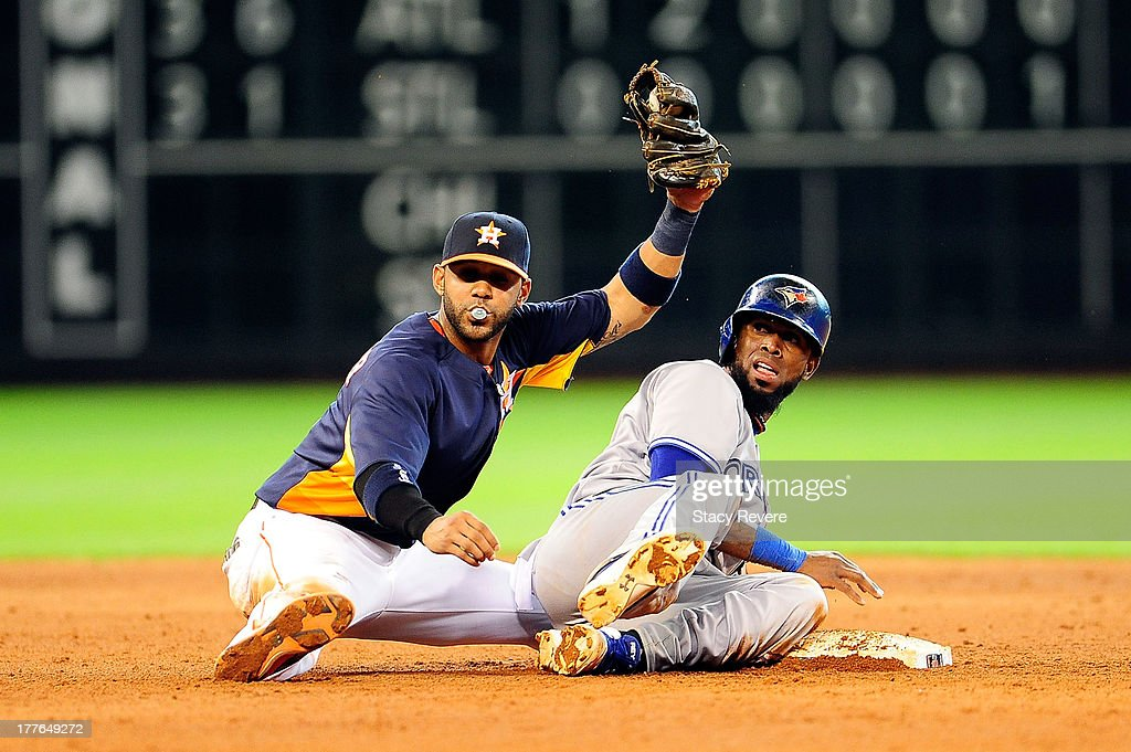 Jose Reyes #7 of the Toronto Blue Jays is put out at second base in the eighth inning by Jonathan Villar #6 of the Houston Astros during a game at Minute Maid Park on August 25, 2013 in Houston, Texas.