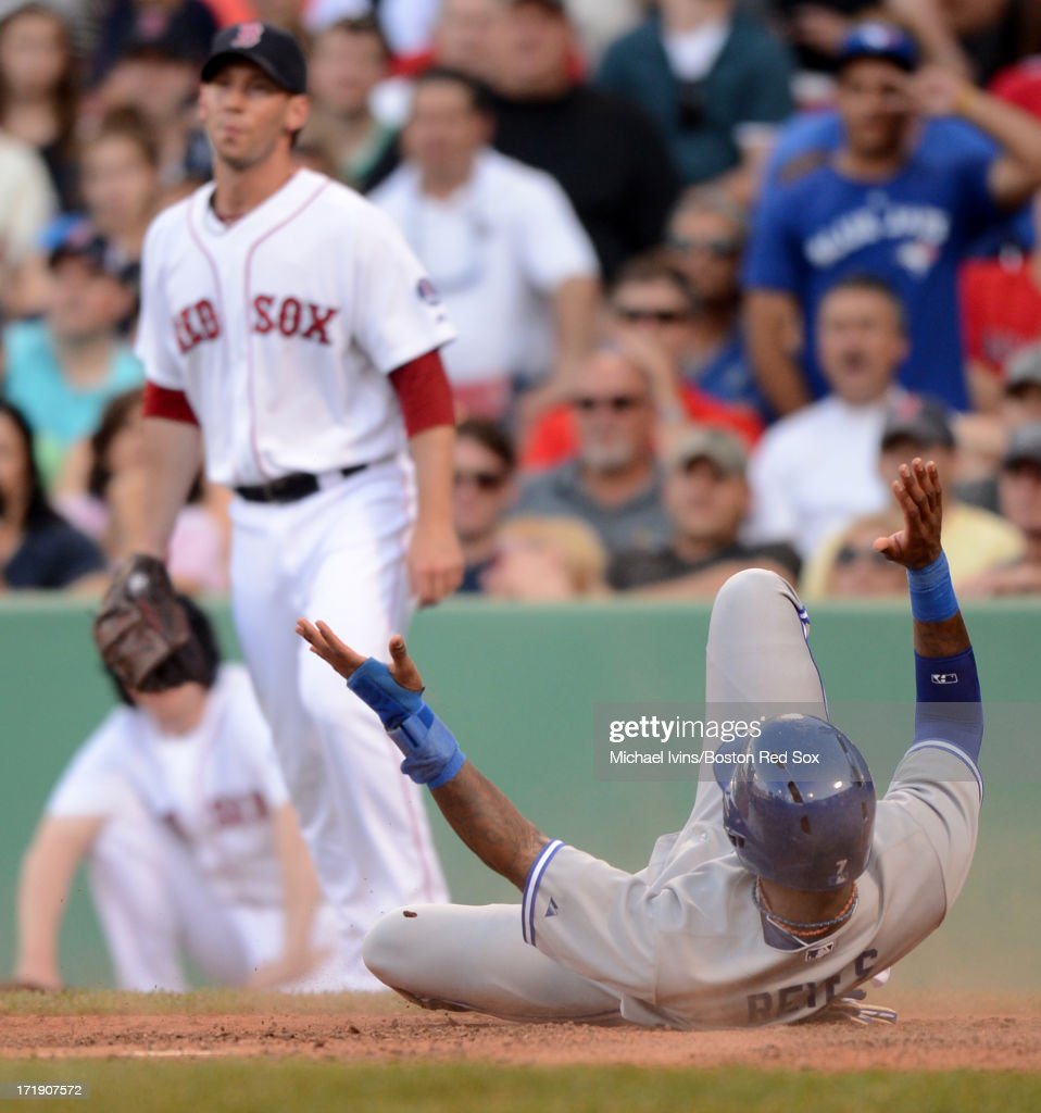 Jose Reyes #7 of the Toronto Blue Jays reacts after scoring a run against Craig Breslow #32 of the Boston Red Sox in the ninth inning on June 29, 2013 at Fenway Park in Boston, Massachusetts.