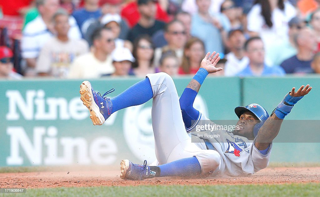 Jose Reyes #7 of the Toronto Blue Jays reacts after scoring a runin the 8th inning against the Boston Red Sox at Fenway Park on June 29, 2013 in Boston, Massachusetts.