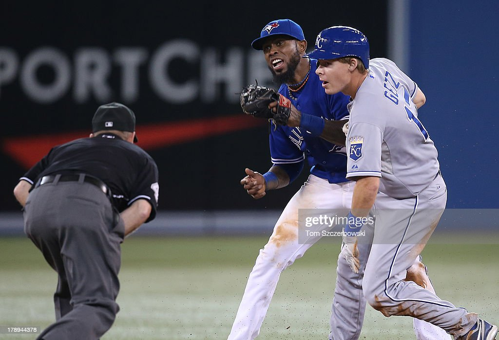 Jose Reyes #7 of the Toronto Blue Jays reacts as he tags out <a gi-track='captionPersonalityLinkClicked' href=/galleries/search?phrase=Chris+Getz&family=editorial&specificpeople=4936717 ng-click='$event.stopPropagation()'>Chris Getz</a> #17 of the Kansas City Royals to end the game on an attempted steal during MLB game action on August 31, 2013 at Rogers Centre in Toronto, Ontario, Canada.